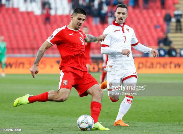 Aleksandar Mitrovic of Serbia in action against Marko Vesovic of Montenegro during the UEFA Nations League C group four match between Serbia and...