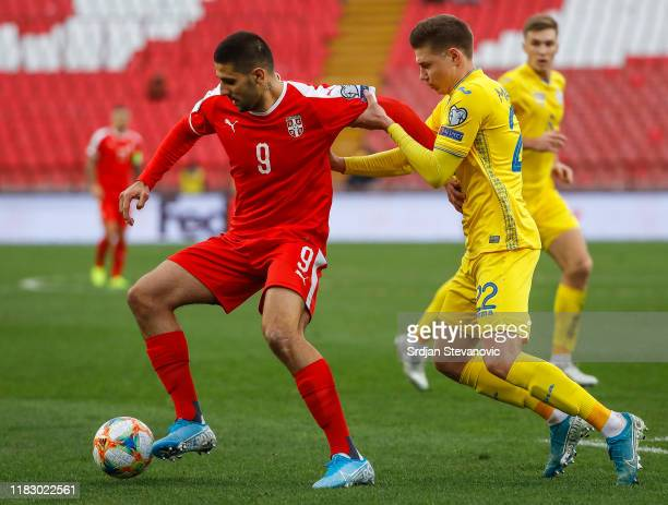 Aleksandar Mitrovic of Serbia in action against Mykola Matviyenko of Ukraine during the UEFA Euro 2020 Qualifier between Serbia and Ukraine on...
