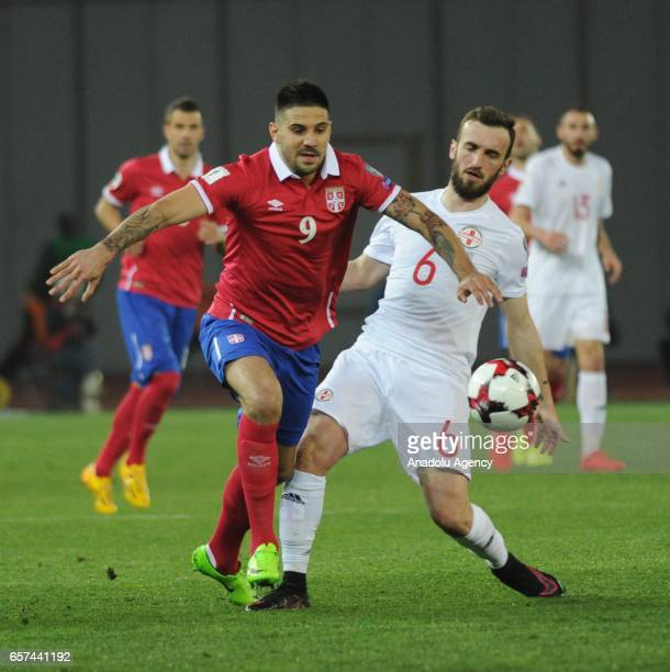 Aleksandar Mitrovic of Serbia in action against Nika Kvekveskiri of Georgia during the 2018 FIFA World Cup Qualification match between Georgia and...