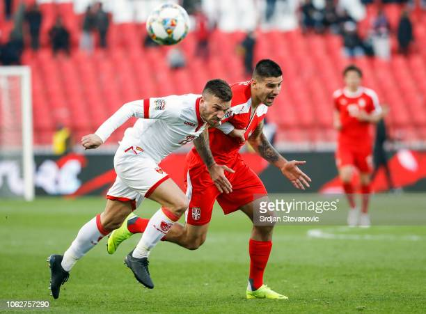 Aleksandar Mitrovic of Serbia is challenged by Marko Simic of Montenegro during the UEFA Nations League C group four match between Serbia and...