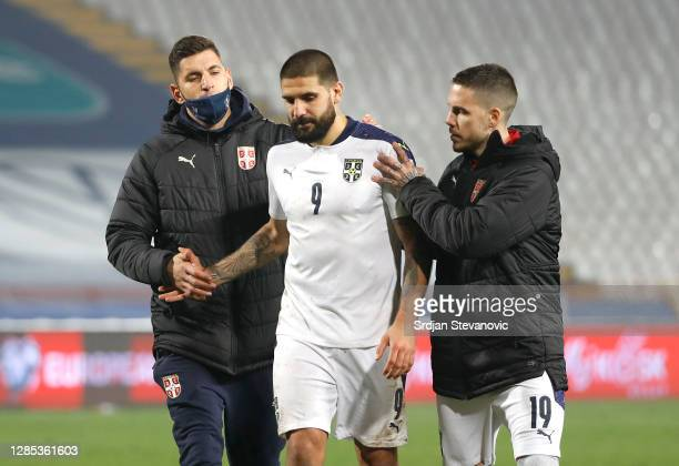 Aleksandar Mitrovic of Serbia is consoled by team mates after his penalty is saved by David Marshall of Scotland during the UEFA EURO 2020 Play-Off...