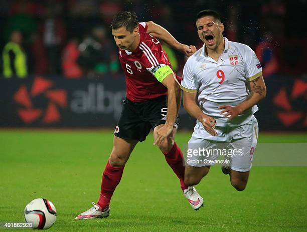 Aleksandar Mitrovic of Serbia is fouled by Lorik Cana of Albania during the UEFA EURO 2016 qualifier between Albania and Serbia at the Elbasan Arena...