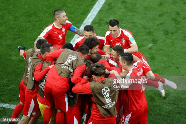 Aleksandar Mitrovic of Serbia is mobbed by teammates as they celebrate the opening goal during the 2018 FIFA World Cup Russia group E match between...