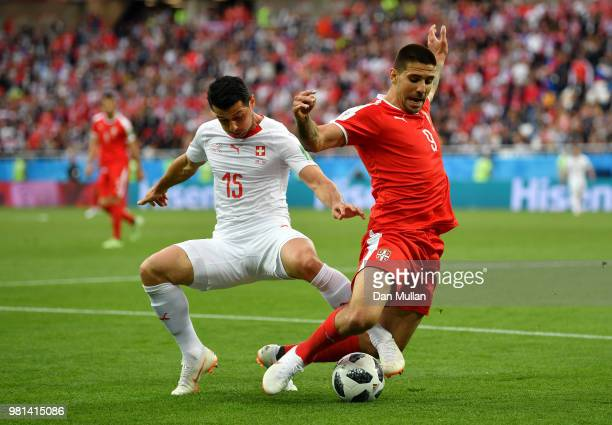 Aleksandar Mitrovic of Serbia is tackled by Blerim Dzemaili of Switzerland during the 2018 FIFA World Cup Russia group E match between Serbia and...