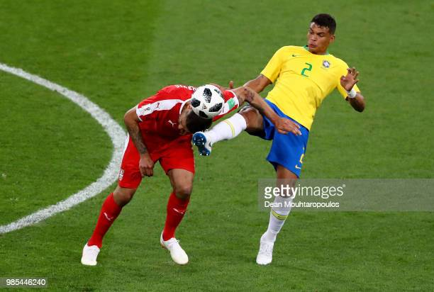 Aleksandar Mitrovic of Serbia is tackled by Thiago Silva of Brazil during the 2018 FIFA World Cup Russia group E match between Serbia and Brazil at...