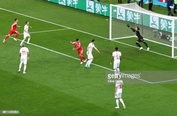 Aleksandar Mitrovic of Serbia scores his team's first goal past Yann Sommer of Switzerland during the 2018 FIFA World Cup Russia group E match...