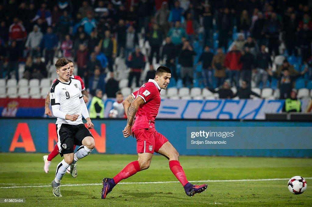 Aleksandar Mitrovic (R) of Serbia scores the goal near Marcel Sabitzer (L) of Austria during the FIFA 2018 World Cup Qualifier between Serbia and Austria at stadium Rajko Mitic on October 9, 2016 in Belgrade, .