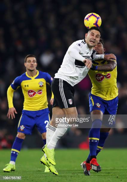Aleksandar Mitrovic wins a header against Mario Lemina during the Premier League match between Fulham FC and Southampton FC at Craven Cottage on...