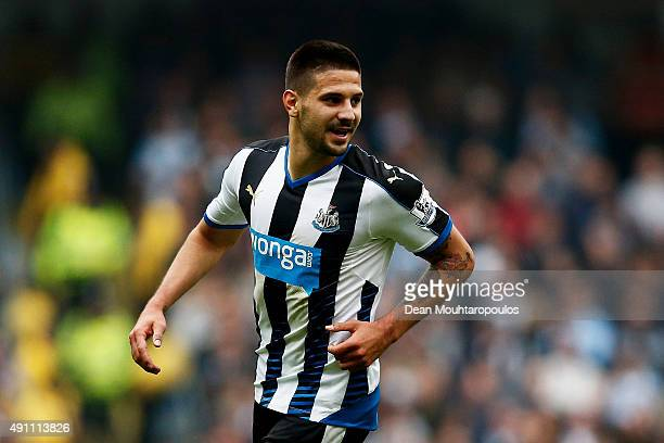 Aleksandar Mitrovicof Newcastle United celebrates scoring his team's first goal during the Barclays Premier League match between Manchester City and...