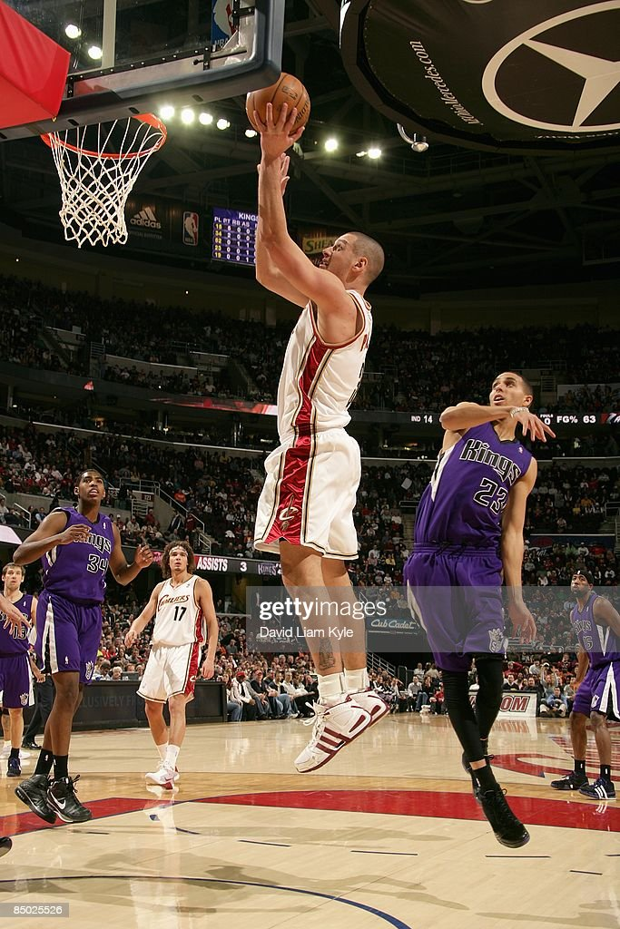Aleksandar Pavlovic #3 of the Cleveland Cavaliers puts up a shot around Kevin Martin #23 of the Sacramento Kings during the game on January 27, 2009 at Quicken Loans Arena in Cleveland, Ohio. The Cavaliers won 117-110.