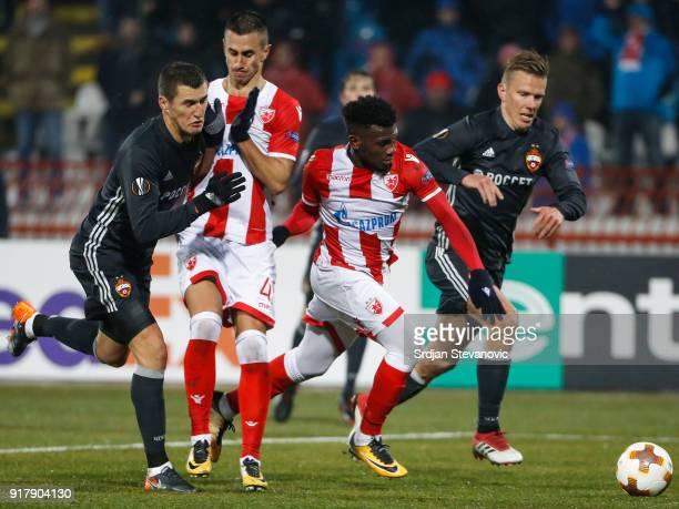 Aleksandar Pesic and El Fardou Ben Nabouhane of Crvena Zvezda in action against Pontus Wernbloom and Viktor Vasin of CSKA Moscow during UEFA Europa...