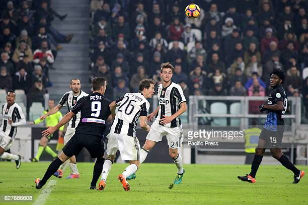 Aleksandar Pesic of Atalanta and Stephan Lichtsteiner of Juventus compete for the ball during the Serie A football match between Juventus FC and...
