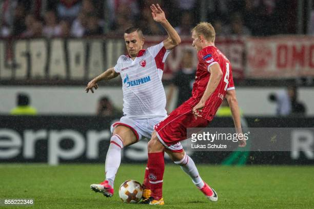 Aleksandar Pesic of Belgrade and Frederik Soerensen of Koeln fight for the ball during the UEFA Europa League group H match between 1 FC Koeln and...