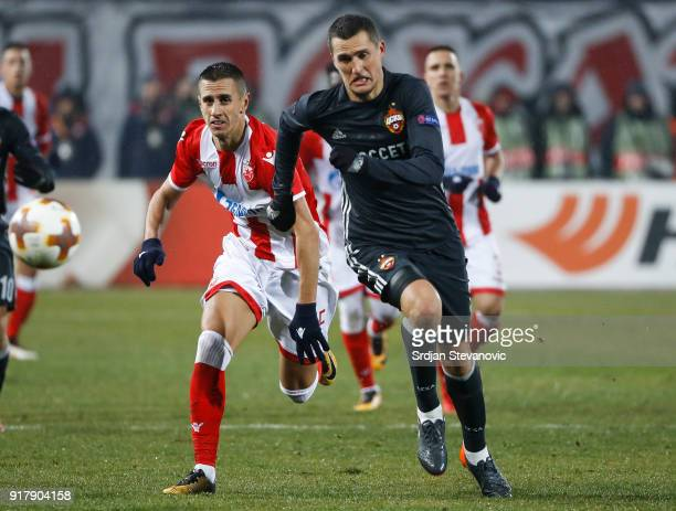 Aleksandar Pesic of Crvena Zvezda competes for the ball against Viktor Vasin of CSKA Moscow during UEFA Europa League Round of 32 match between...