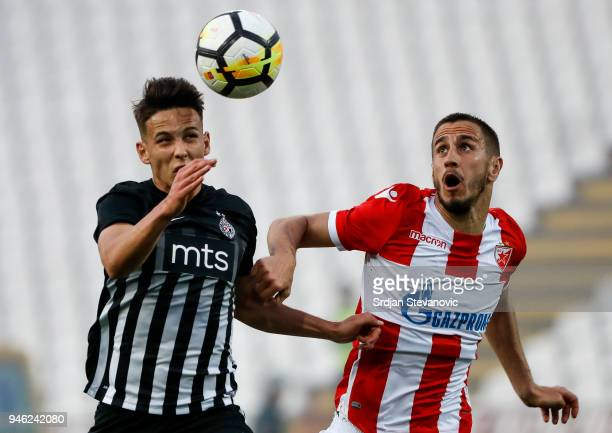 Aleksandar Pesic of Crvena Zvezda competes for the ball against Svetozar Markovic of Partizan during the Serbian Super League Play Off match at the...