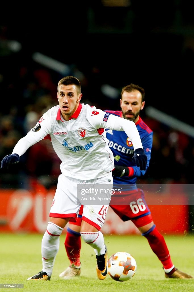 Aleksandar Pesic (L) of Crvena Zvezda in action against Bibras Natcho (R) of CSKA Moscow during the UEFA Europa League round of 32, second leg soccer match between CSKA Moscow and Crvena Zvezda at the Stadium CSKA Moscow in Moscow, Russia on February 21, 2018.