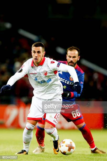 Aleksandar Pesic of Crvena Zvezda in action against Bibras Natcho of CSKA Moscow during the UEFA Europa League round of 32 second leg soccer match...