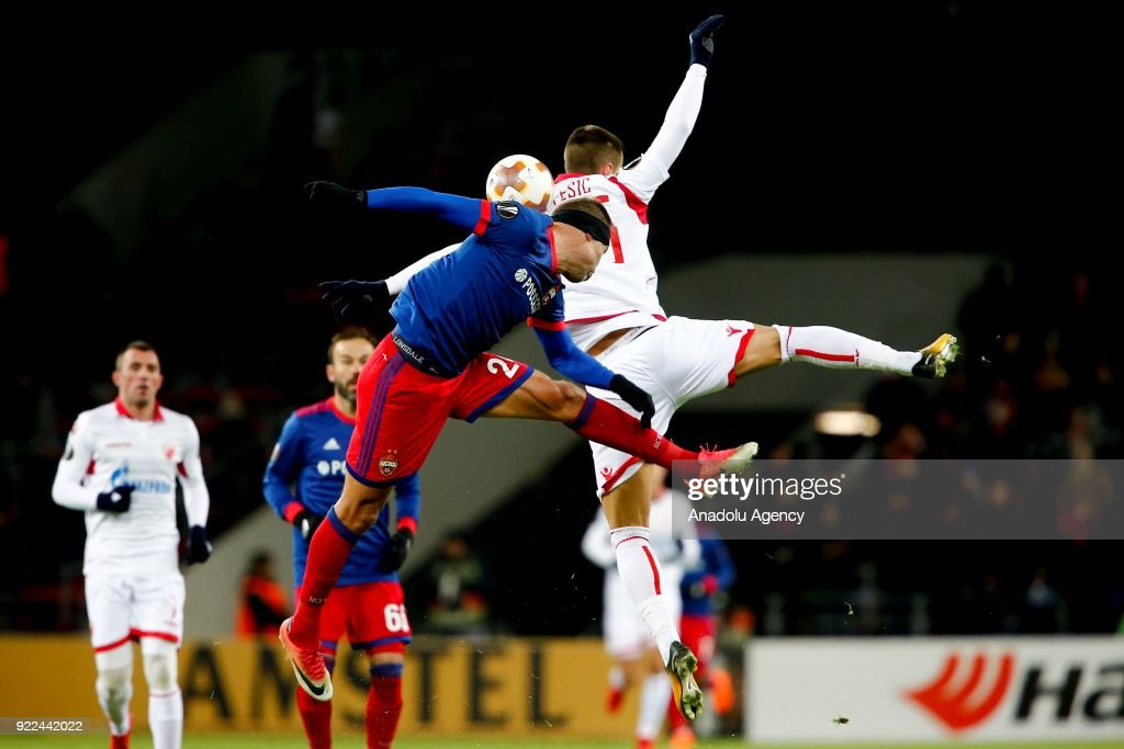Aleksandar Pesic (R) of Crvena Zvezda in action against Vasili Berezutski (L) of CSKA Moscow during the UEFA Europa League round of 32, second leg soccer match between CSKA Moscow and Crvena Zvezda at the Stadium CSKA Moscow in Moscow, Russia on February 21, 2018.