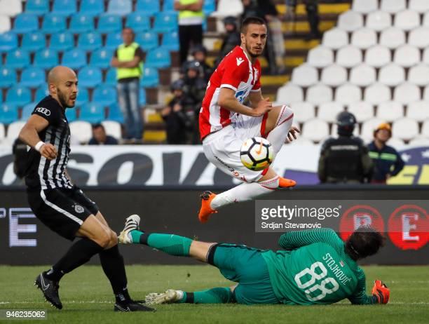 Aleksandar Pesic of Crvena Zvezda scores the goal over Goalkeeper Vladimir Stojkovic and Nemanja Miletic of Partizan during the Serbian Super League...