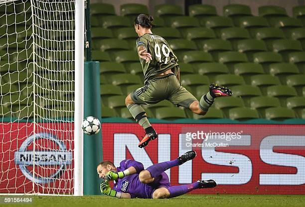 Aleksandar Prijovic of Legia Warsaw scores during the Champions League qualifying round game between Dundalk and Legia Warsaw at Aviva Stadium on...