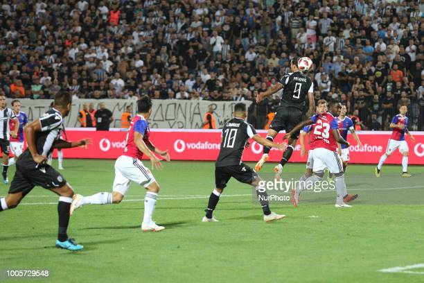 Aleksandar Prijovic of PAOK hits the ball during Champions League second qualifying round first leg football match between PAOK FC and FC Basel at...