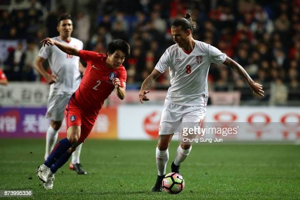 Aleksandar Prijovic of Serbia competes for the ball with Choi ChulSoon of South Korea during the international friendly match between South Korea and...