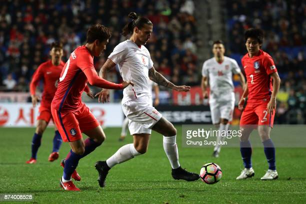 Aleksandar Prijovic of Serbia competes for the ball with Jang HyunSoo of South Korea during the international friendly match between South Korea and...