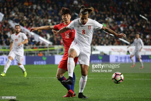 Aleksandar Prijovic of Serbia competes for the ball with Ki SungYueng of South Korea during the international friendly match between South Korea and...
