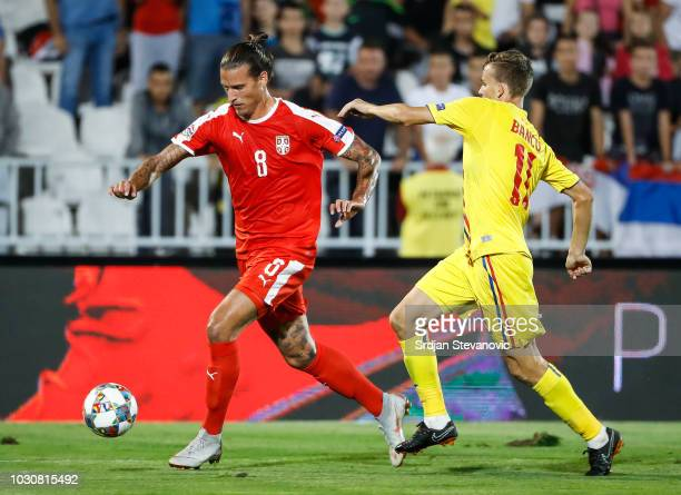 Aleksandar Prijovic of Serbia in action against Nicusor Bancu of Romania during the UEFA Nations League C group four match between Serbia and Romania...