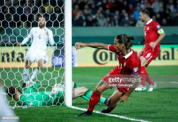 Aleksandar Prijovic of Serbia scores a goal against goalkeeper Giorgi Makaridze of Georgia during the FIFA 2018 World Cup Qualifier between Serbia...