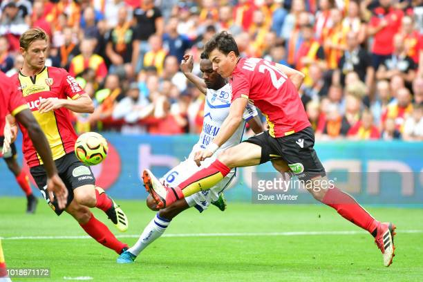 Aleksandar Radovanovic of Lens and Adama Niane of Troyes during the French Ligue 2 match between RC Lens and Troyes at Stade BollaertDelelis on...
