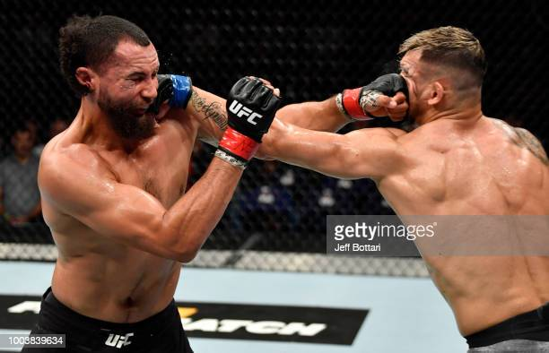 Aleksandar Rakic of Austria and Justin Ledet trade punches in their light heavyweight bout during the UFC Fight Night at Barclaycard Arena on July 22...