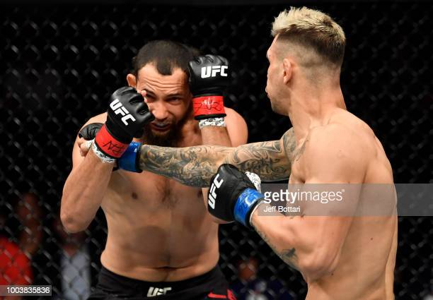 Aleksandar Rakic of Austria punches Justin Ledet in their light heavyweight bout during the UFC Fight Night at Barclaycard Arena on July 22 2018 in...