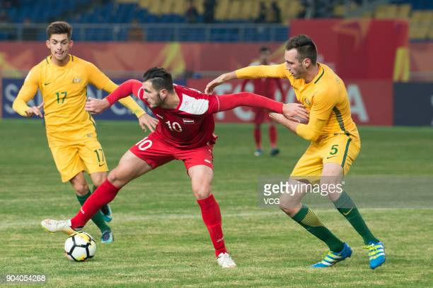 Aleksandar Susnjar of Australia and Mohamad Rafat Muhtadi of Syria compete for the ball during the AFC U23 Championship Group D match between...