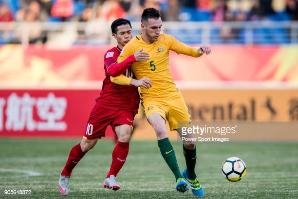 Aleksandar Susnjar of Australia fights for the ball with Nguyen Cong Phuong of Vietnam during the AFC U23 Championship China 2018 Group D match...