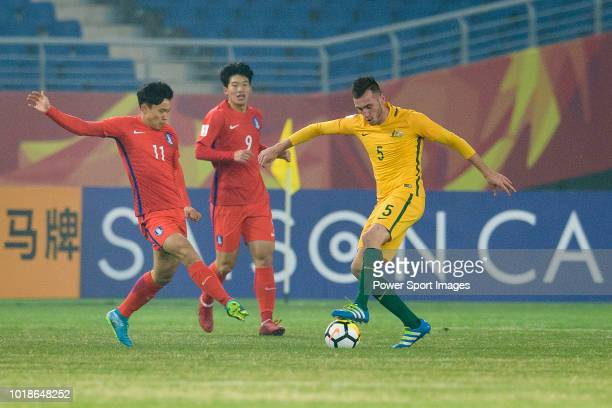 Aleksandar Susnjar of Australia in action against Cho Young Wook of South Korea during the AFC U23 Championship China 2018 Group D match between...