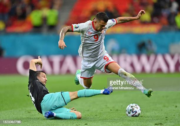 Aleksandar Trajkovski of North Macedonia is challenged by Stefan Lainer of Austria during the UEFA Euro 2020 Championship Group C match between...