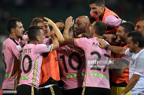 Aleksandar Trajkovski of Palermo celebrates with teammates after scoring the opening goal during the Serie B match between US Citta' di Palermo and...