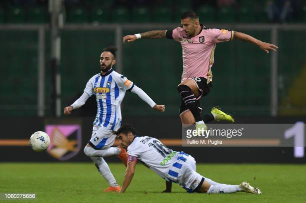 Aleksandar Trajkovski of Palermo jumps as Gaston Brugman of Pescara tackles during the Serie B match between US Citta di Palermo and Pescara Calcio...