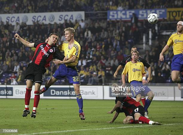 Aleksandar Vasoski of Frankfurt heads the ball past Morten Rasmussen of Brondby to score his second goal during the UEFA Cup second leg match between...