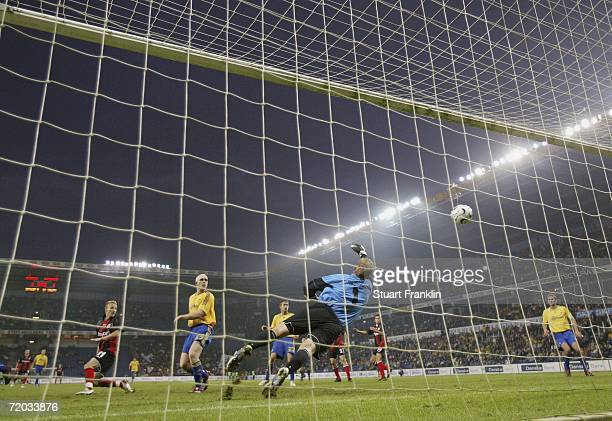 Aleksandar Vasoski of Frankfurt heads the ball past Morten Rasmussen of Brondby to score his second goal during the UEFA Cup second leg match between...
