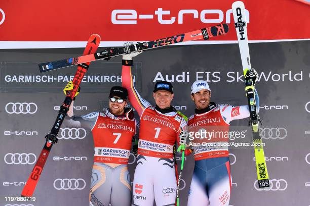 Aleksander Aamodt Kilde of Norway takes 2nd place Thomas Dressen of Germany takes 1st place Johan Clarey of France takes 3rd place during the Audi...
