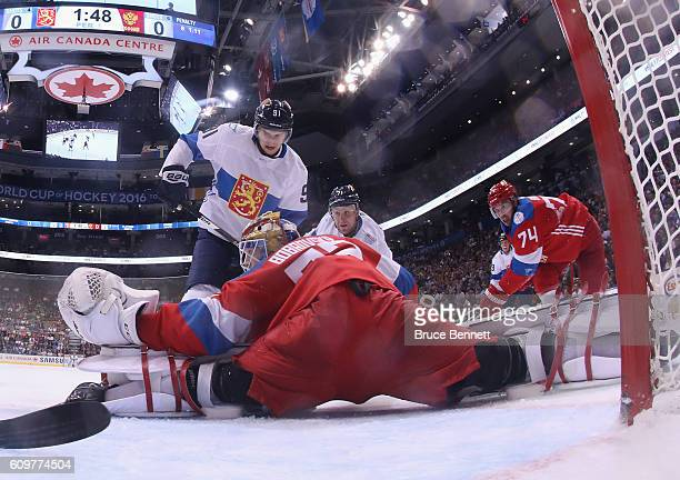 Aleksander Barkov and Leo Komarov of Team Finland converge on Sergei Bobrovsky of Team Russia during the first period during the World Cup of Hockey...