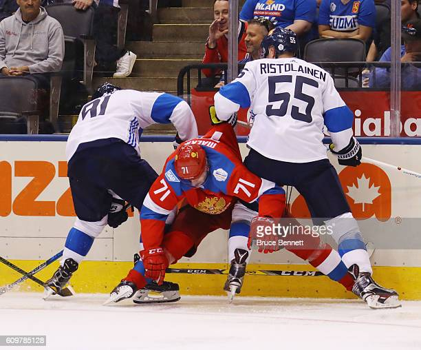 Aleksander Barkov and Rasmus Ristolainen of Team Finland defend against Evgeni Malkin of Team Russia during the World Cup of Hockey tournament at the...
