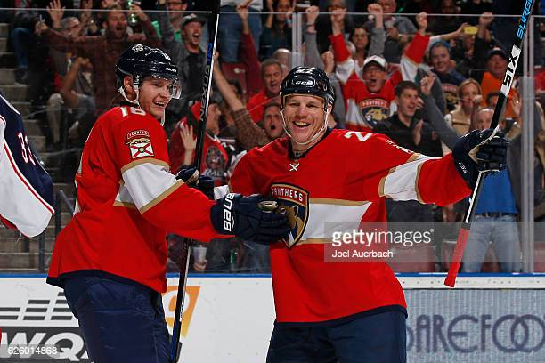 Aleksander Barkov and Shawn Thornton celebrate the first period goal score by Jaromir Jagr of the Florida Panthers against the Columbus Blue Jackets...