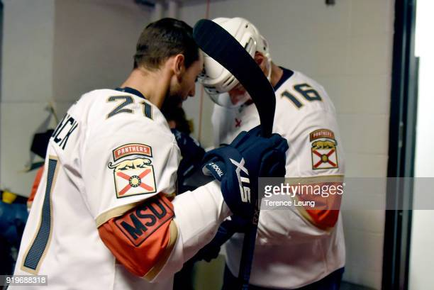 Aleksander Barkov and Vincent Trocheck of the Florida Panthers sport a Marjory Stoneman Douglas High School badge on his jersey as they wait for...
