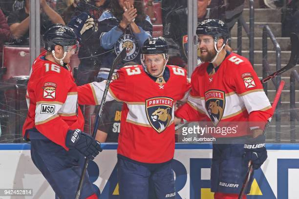 Aleksander Barkov celebrates his first period goal with Aaron Ekblad and Evgeni Dadonov of the Florida Panthers against the Boston Bruins at the BBT...