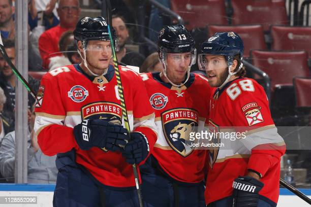 Aleksander Barkov celebrates his first period goal with Mike Hoffman and Mark Pysyk of the Florida Panthers xagainstthe Ottawa Senators at the BBT...