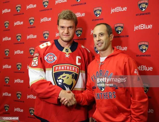 Aleksander Barkov left is named the captain of the Florida Panthers on Monday Sept 17 2018 Former captain Derek MacKenzie right hands over the...