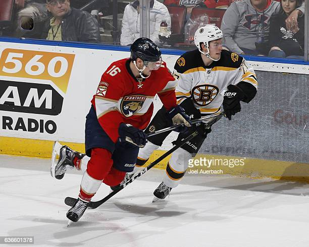 Aleksander Barkov of the Florida Panthers and Austin Czarnik of the Boston Bruins chase a loose puck during second period action at the BBT Center on...